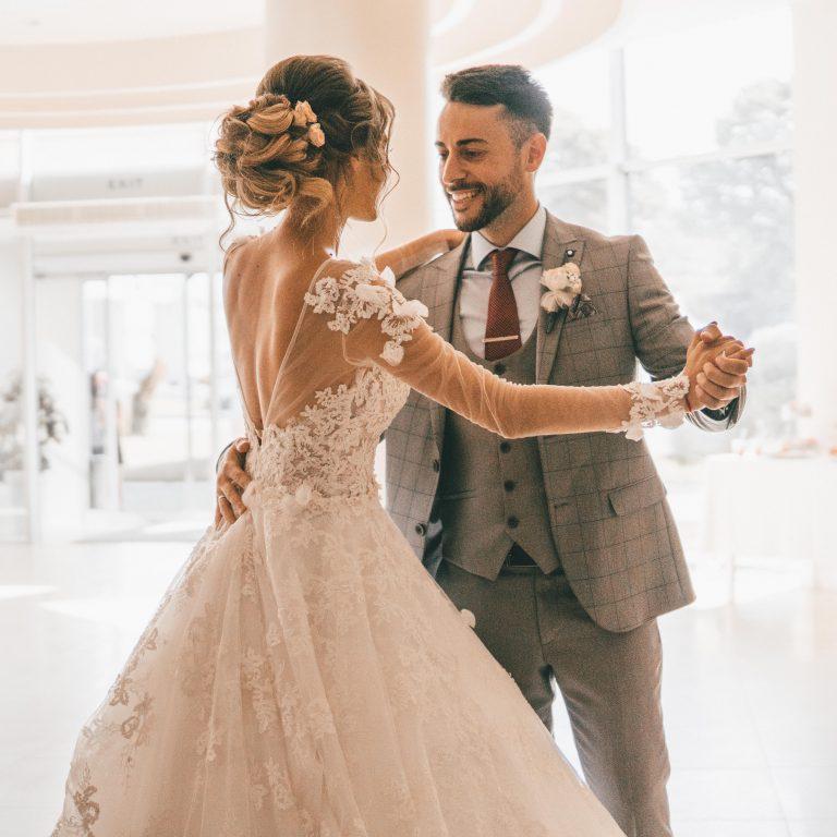 Newlywed couple having their first wedding dance